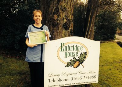 Our manager Claire, holding our certificate of merit for training skills, presented by the West Berkshire Training Consortium